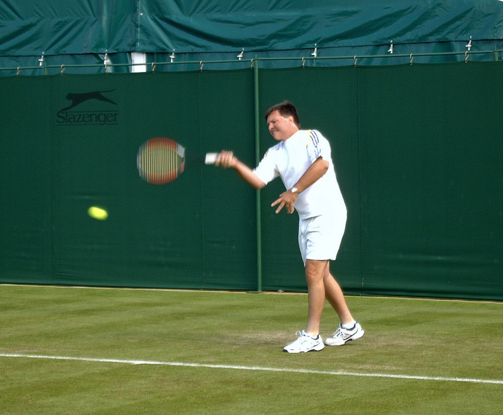 Dr. John F Murray coaching tennis at Wimbledon